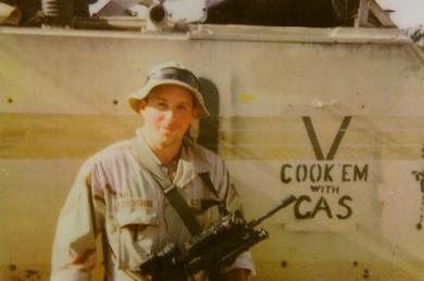 """Cook 'em With CAS"": Mike next to his track (Bradley) in Iraq."